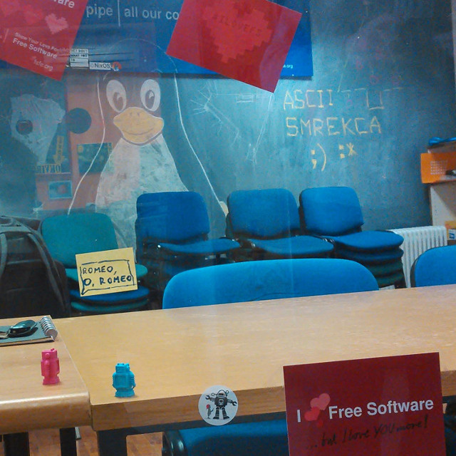 hackerspace with #ilovefs posters, postcard, robot saying Romeo, oh Romeo